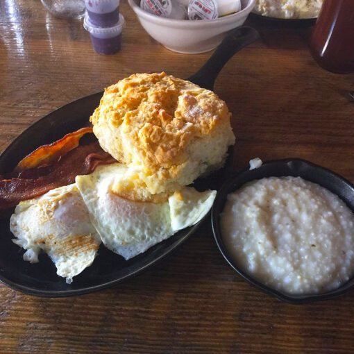 """The """"Traditional"""" with Two Eggs, Bacon, Grits and a Biscuit."""